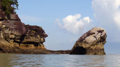 Rock formation rising from the sea