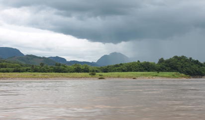Weather changing over a mountain above Mekong River