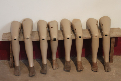 Prosthetic legs on bench