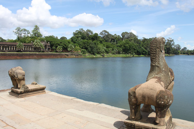 The statues guarding the entrance over the moat to Angkor Wat