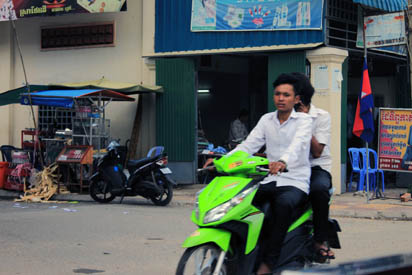 Cambodian with lime green scooter