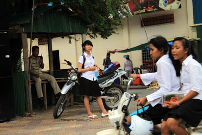 School girls with their mopeds
