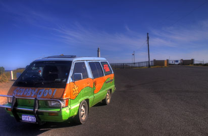 Mystery Machine beside lighthouse