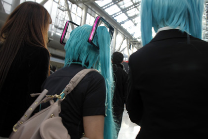 Popular Manga Cosplay at Comiket, not sure where this is from