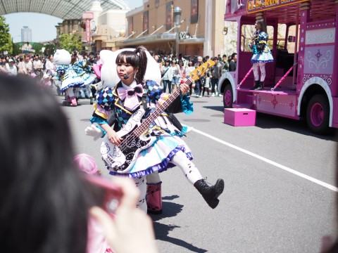 Girl performing for some hello kitty band